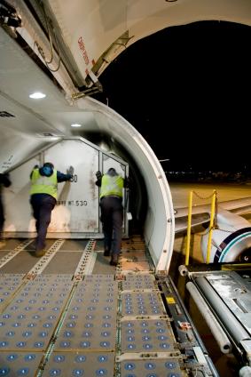 men loading cargo plane